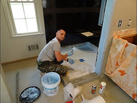 team of handymen working in Norfolk Virginia on bathroom remodeling services