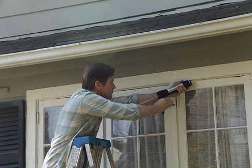 Maryland Insulation Expert working on Window
