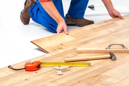 handyman working on flooring installatio