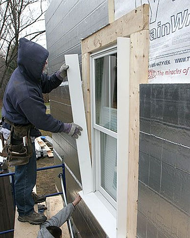 insulation expert working on windows and doors insulation service in Indianapolis Indiana