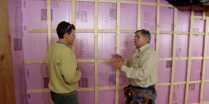 insulation expert working on basement in