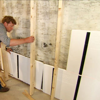 Man working on wall insulation