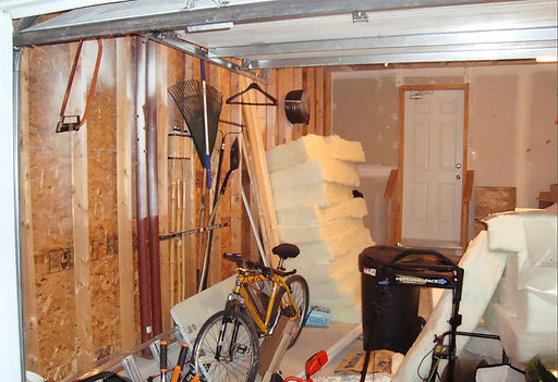 insulation expert working on garage insulation service in Indianapolis Indiana