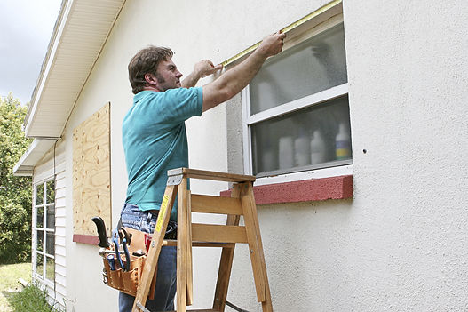 Corona California window services being done by a team of handymen