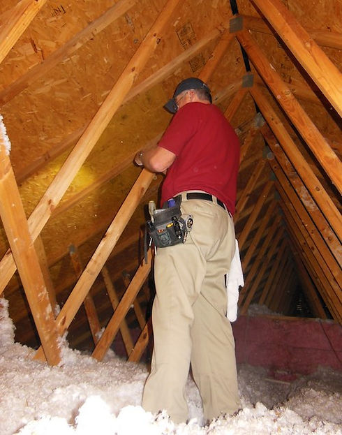 Indianapolis Indiana attic insulation service work being done by an insulation expert