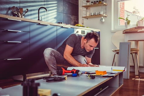 a handyman working in Corona California on kitchen remodeling service