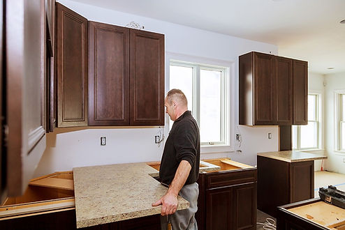 team of handymen working in Mobile Alabama  on kitchen remodeling services