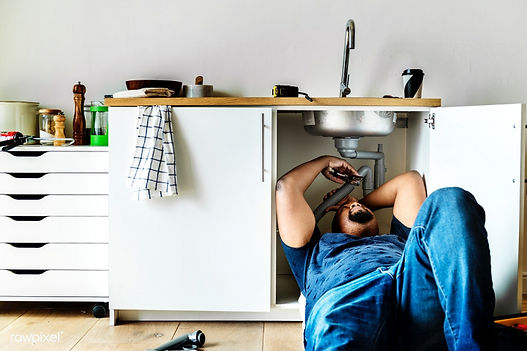 Corona California plumbing services work being done by a handyman