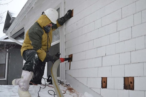 team of insulation experts working in Indianapolis Indiana on cellulose insulation service