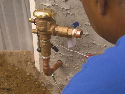 Norfolk Virginia plumbing services work being done by a handyman
