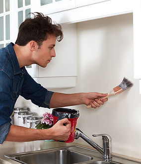 handyman working on painting services in Corona California