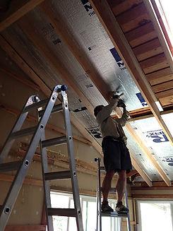 Baltimore, MD insulation expert working on garage insulation services
