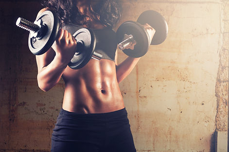 Fitness woman in training.Strong abs showing.jpg