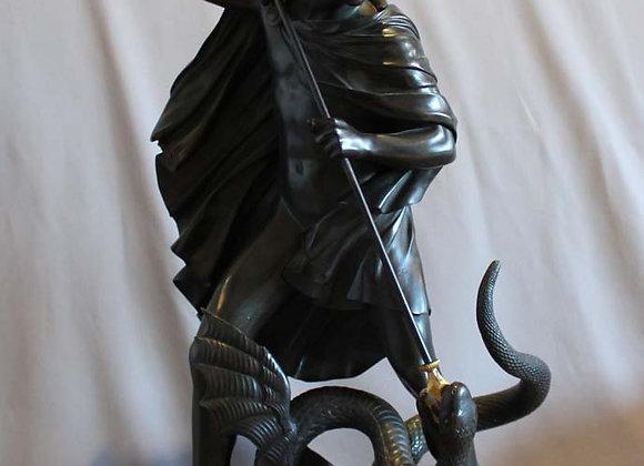 Antique bronze of Jason fighting the dragon for the golden fleece.