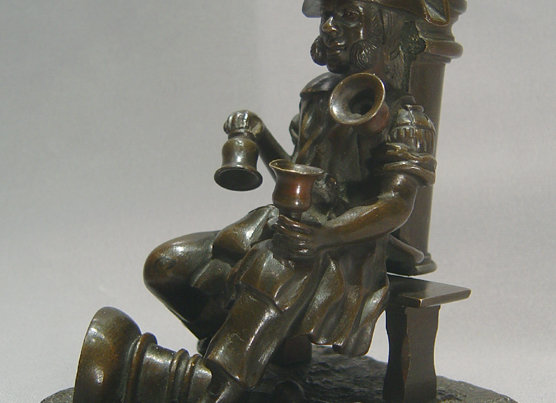 Antique French bronze match strike in the form of an old soldier as a water sell