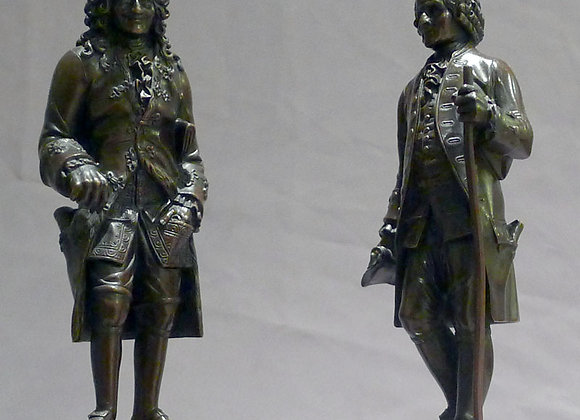 Antique pair of unusually fine bronzes of Rousseau and Voltaire