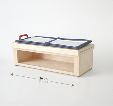 EXAMINATION TABLE WITH SLIDING TOP