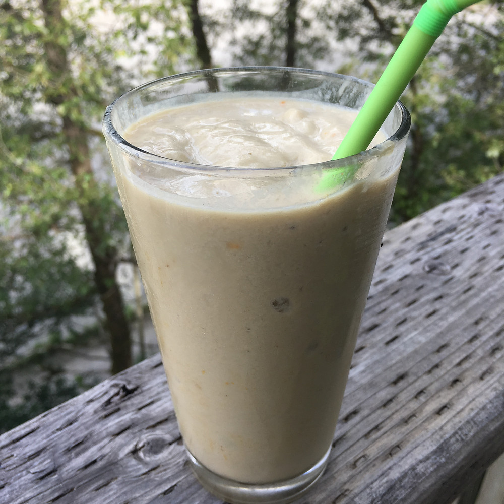 still life with mango protein smoothie