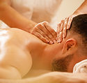 Close-up of therapist massaging man's ne