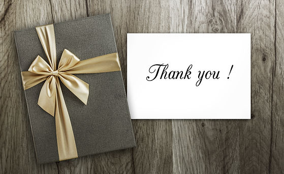 Present and Thank you card on wood.jpg