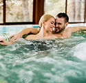 96806481-loving-couple-relaxing-in-hot-t