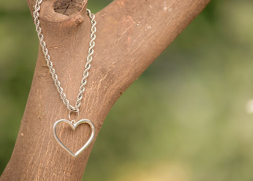 Heart%20necklace%20hanging%20on%20a%20br