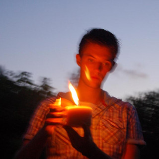 Young Man with Candle