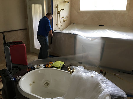 Contractor performing flood damage repairs