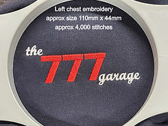 The 777 garage left chest embroidery showing design details