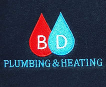 Plumbing & Heating embroidery in red, blue and white threads