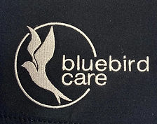Bluebird Care logo embroidery in cream thread