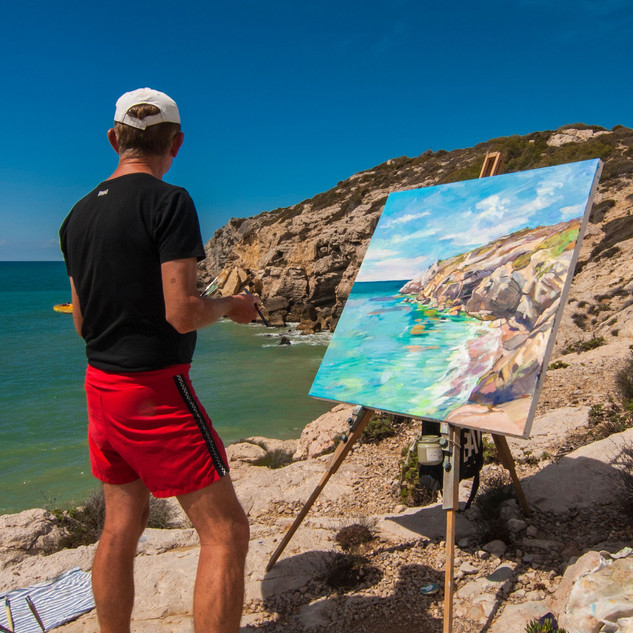James painting cliffs by Sitges