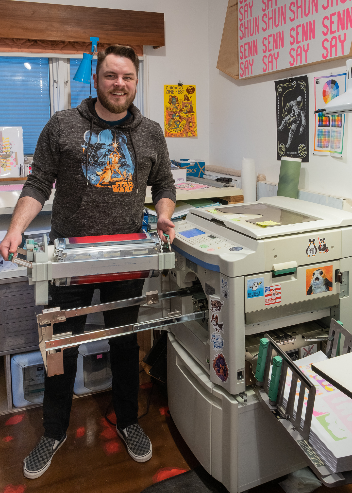 Will Arnold with a risograph press