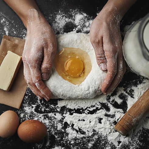 baker-working-with-dough-and-egg.jpg