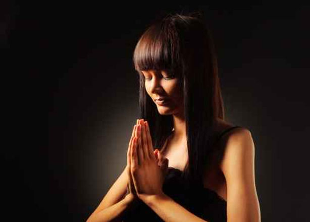 woman praying black.jpg