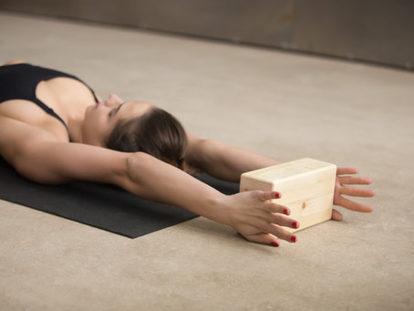 Do you suffer with a sore lower back? Using a yoga block during practice can help you.