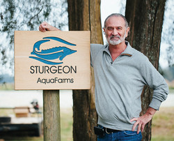 Mark with aquafarm sign.jpg