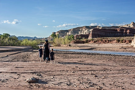 mother and kids in the desert