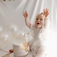 Cute birthday girl with her smash cake