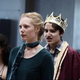 Lear disowns Cordelia (Madeline Wall) while Girl 2, as Goneril (Eliza Convis) and Girl 3, as Regan (Ava Lalezarzadeh) jeer.