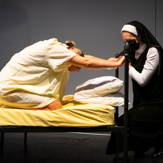 Juliet works through a contraction as Francisca holds space.