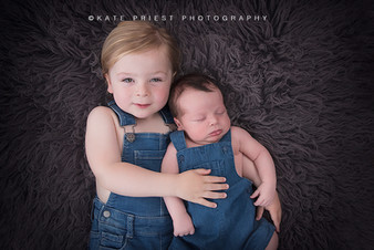 Kate Priest the newborn and baby photographer photographing two brothers together