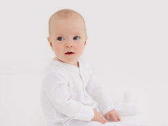 white studio baby photoshoot