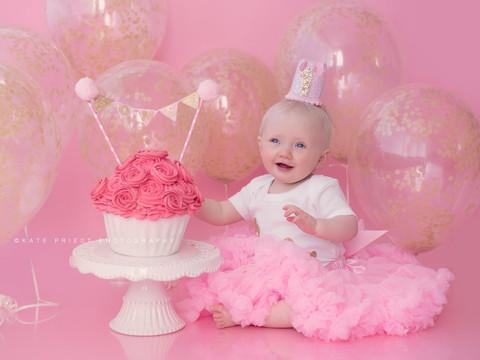 Pink baby girl cake smash
