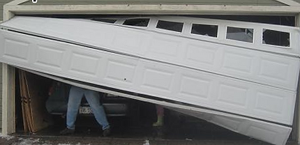 Garage door stuck and came off the tracks