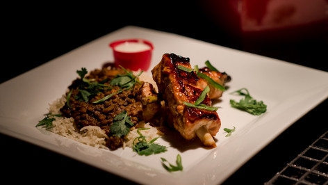 Lemongrass salmon skewers with rice and spicy puy lentils