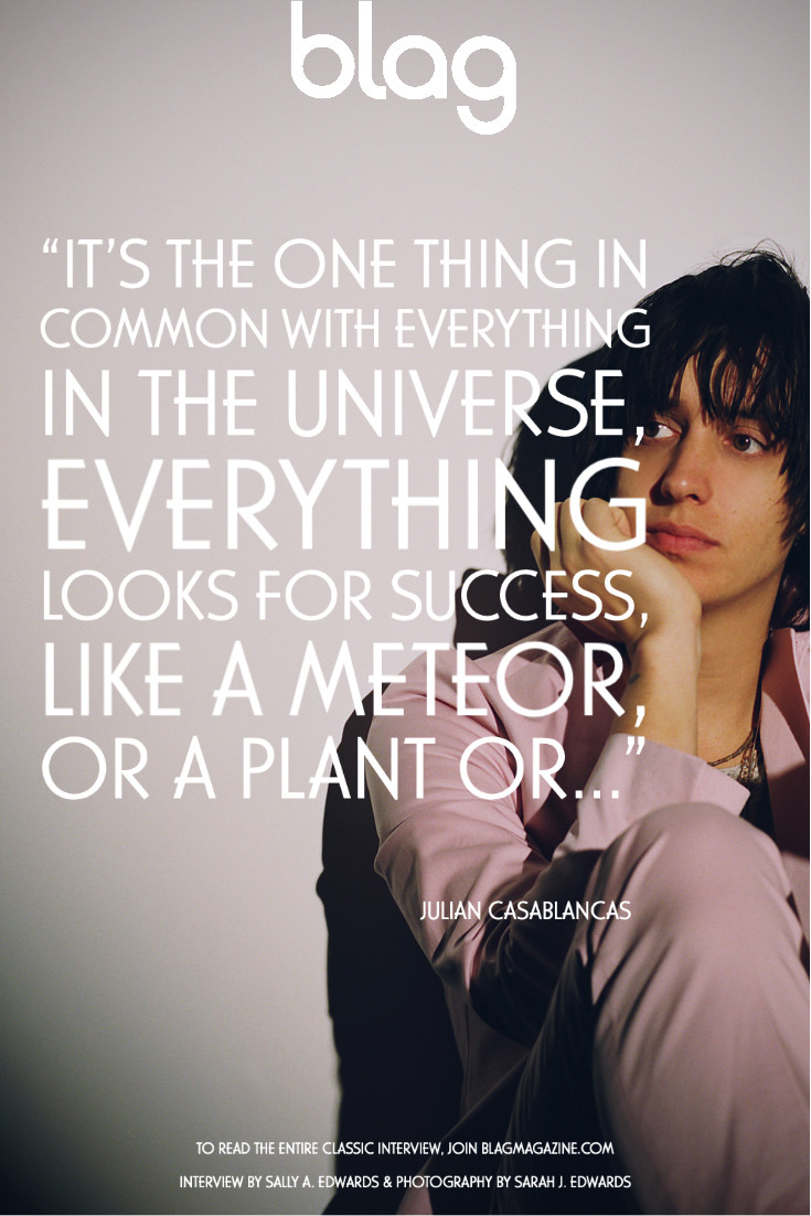Julian Casablancas for BLAG magazine. Julian sits on the floor, wearing a pink suit. Quote overlay about how the 'one think in common with everything in the universe, everything looks for success'.