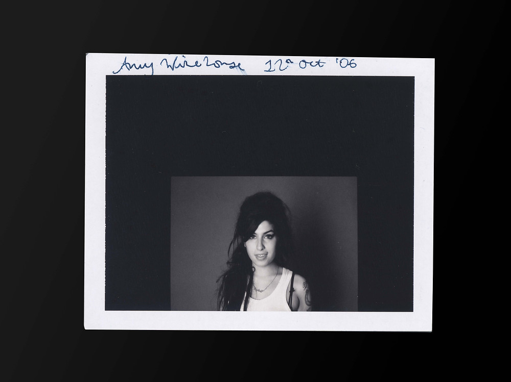 A portrait of Amy Winehouse by Sarah J. Edwards. Black and White, studio shoot. Polaroid film.
