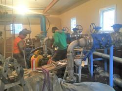 Welders working on pumphouse spoolwork