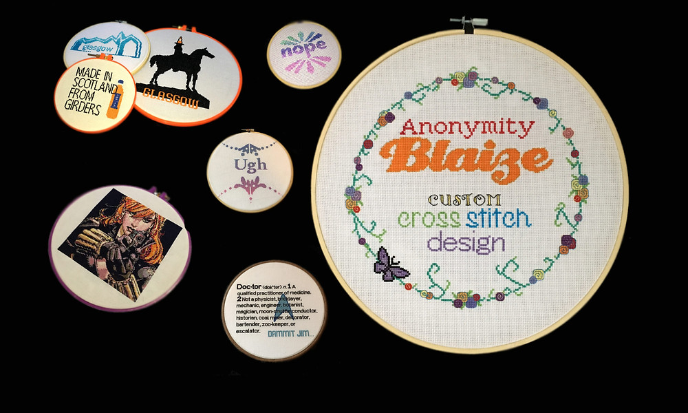 A photo of some cross-stitched items.